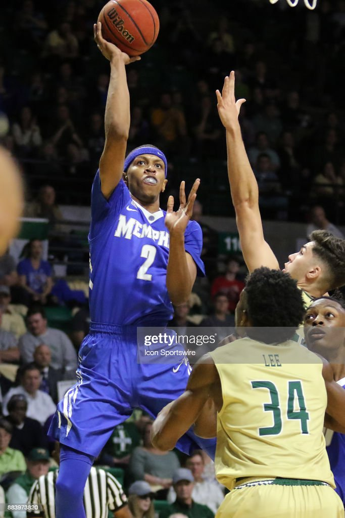 Memphis Tigers forward Jimario Rivers (2) takes a shot over UAB defenders in the game between the Memphis Tigers and the UAB Blazers on November 30, 2017 at Bartow Arena in Birmingham, Alabama.