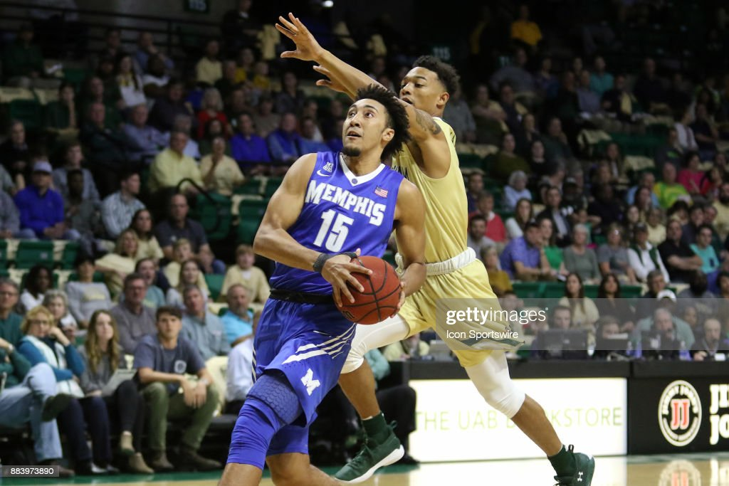 Memphis Tigers guard David Nickelberry (15) drives past UAB Blazers guard Deion Lavender (5) during the game between the Memphis Tigers and the UAB Blazers on November 30, 2017 at Bartow Arena in Birmingham, Alabama.