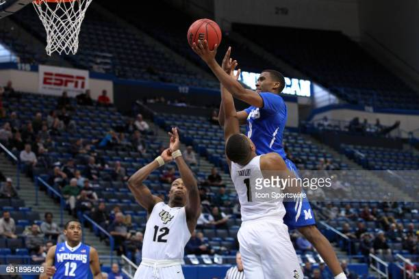 Memphis Tigers guard Jeremiah Martin shoots over UCF Knights guard AJ Davis and UCF Knights guard BJ Taylor during the second half of the American...