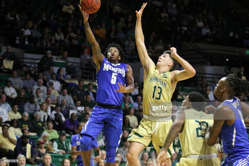 Memphis Tigers guard Kareem Brewton Jr. (5) drives past UAB Blazers guard Nate Darling (13) for a layup in the game between the Memphis Tigers and the UAB Blazers on November 30, 2017 at Bartow Arena in Birmingham, Alabama.