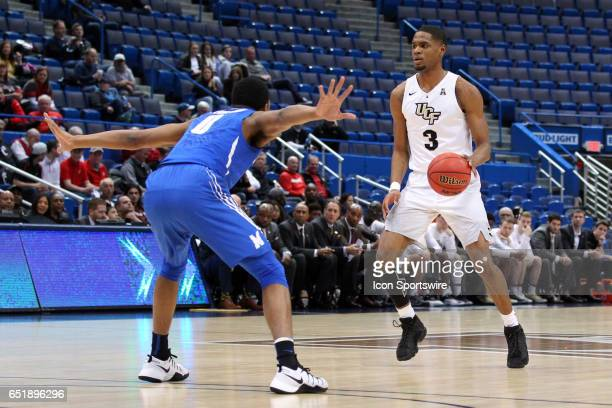 Memphis Tigers guard KJ Lawson defends UCF Knights guard AJ Davis during the first half of the American Athletic Conference quarterfinal game between...