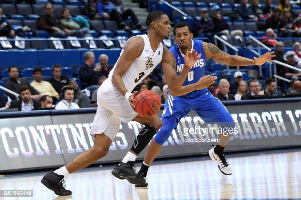 Memphis Tigers guard KJ Lawson defends UCF Knights guard AJ Davis during the second half of the American Athletic Conference quarterfinal game...