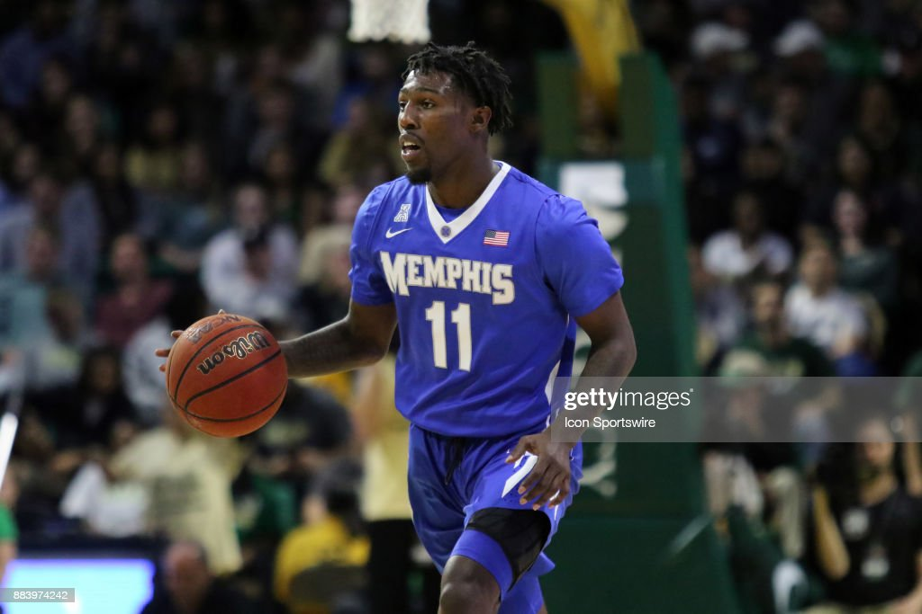 Memphis Tigers guard Malik Rhodes (11) brings the ball up the court during the game between the Memphis Tigers and the UAB Blazers on November 30, 2017 at Bartow Arena in Birmingham, Alabama.