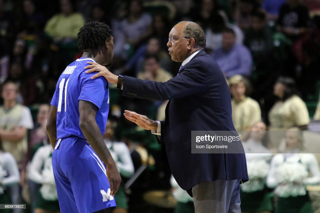 Memphis Tigers head coach Tubby Smith chats with Memphis Tigers guard Malik Rhodes (11) during a break in the action in the game between the Memphis Tigers and the UAB Blazers on November 30, 2017 at Bartow Arena in Birmingham, Alabama.