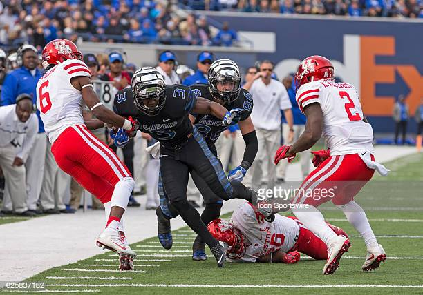 Memphis wide receiver Anthony Miller attempts to run through Houston corner back Howard Wilson and safety Khalil Williams with Houston corner back...