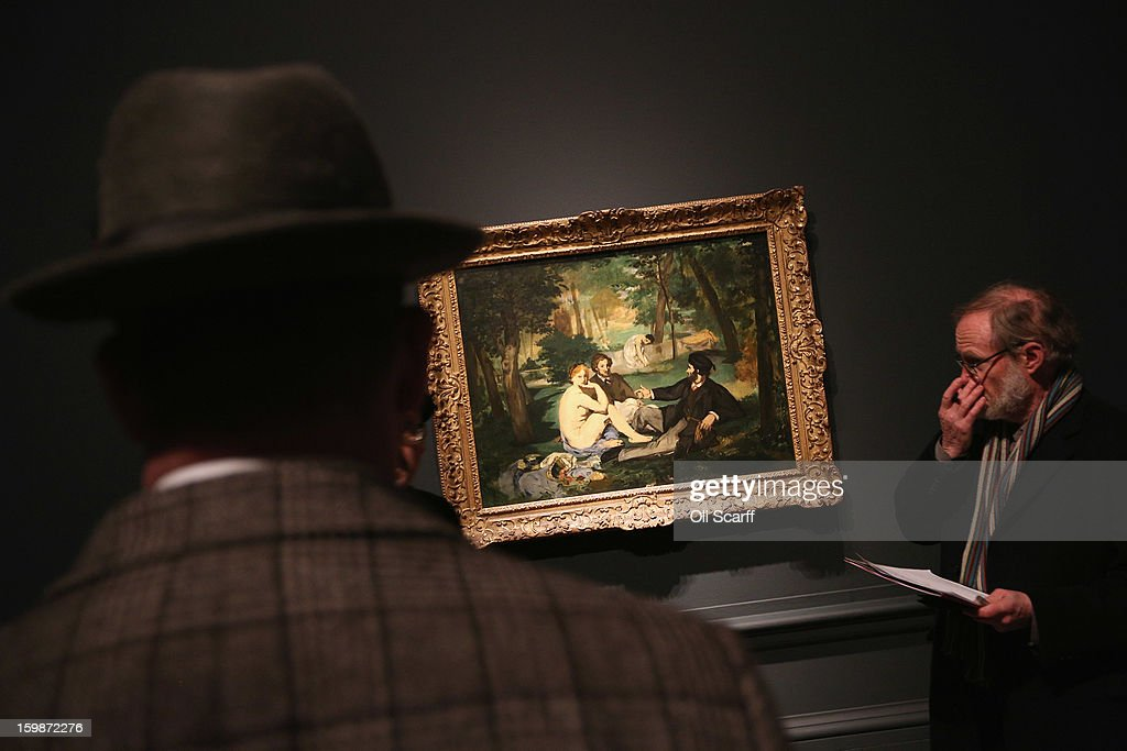 Men admire a painting by Edouard Manet entitled 'Dejeuner sur l'herbe' in the Royal Academy of Arts on January 22, 2013 in London, England. The painting features in the Royal Academy's new exhibition 'Manet: Portraying Life' which displays over 50 paintings spanning his career. The exhibition open to the general public on January 26, 2013 and runs until April 14, 2013.