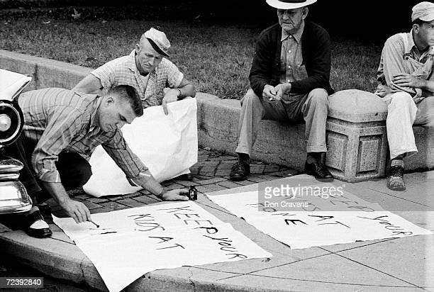 Men against the desegregation of schools making signs reading KEEP YOUR KIDS AT HOME