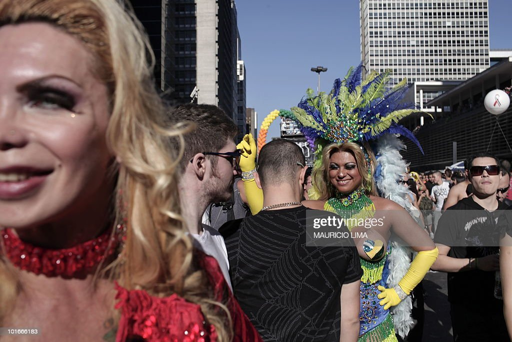 Men and drag queens participate in the annual gay pride parade held in the financial district of Paulista Avenue, in downtown Sao Paulo, Brazil, on June 6, 2010. Three million people were expected to take part in the annual gay parade in Sao Paulo, according to organizers. The colorful march under a sunny sky was to stream along the city's main avenue towards the center where all-night partying would ensue. AFP PHOTO/Mauricio LIMA