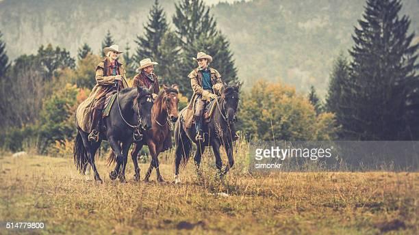 Men and woman enjoying horse riding