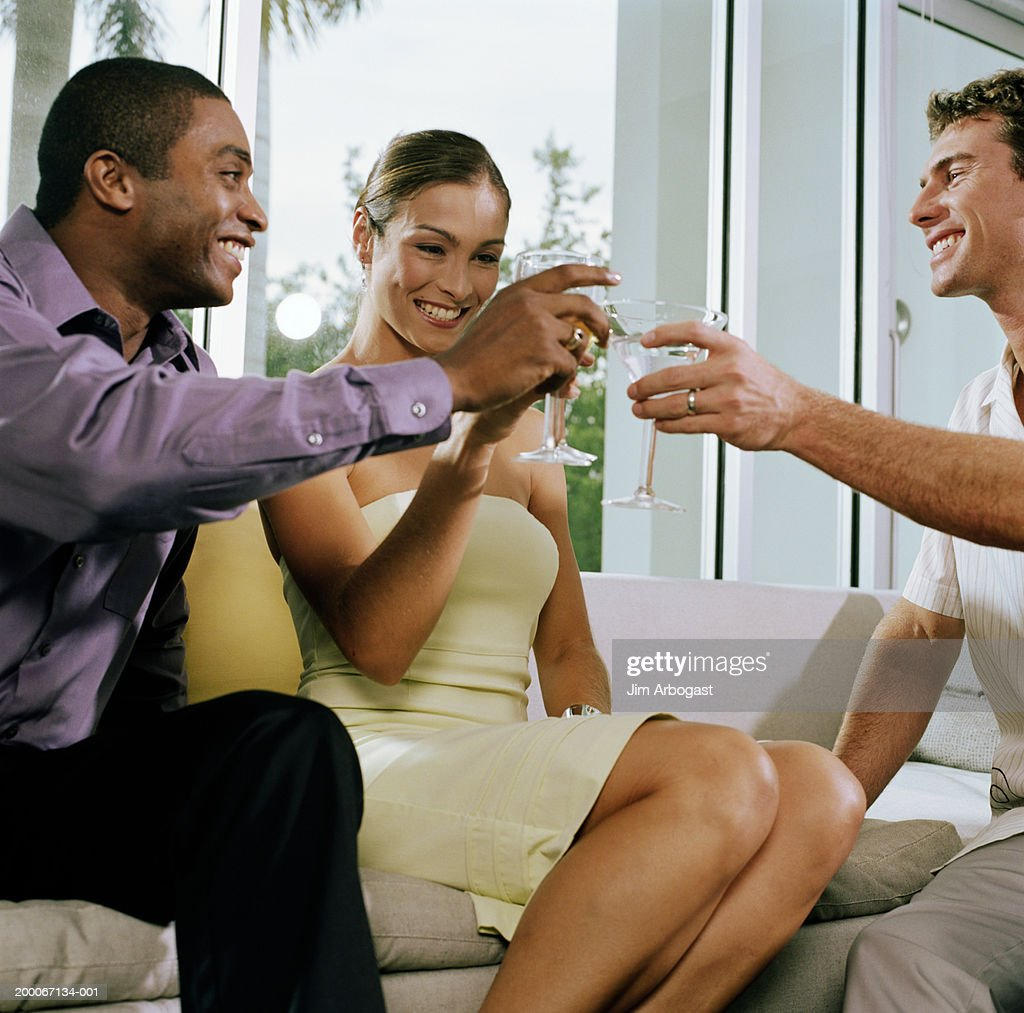 Men and woman toasting at cocktail party, low angle view : Stock Photo