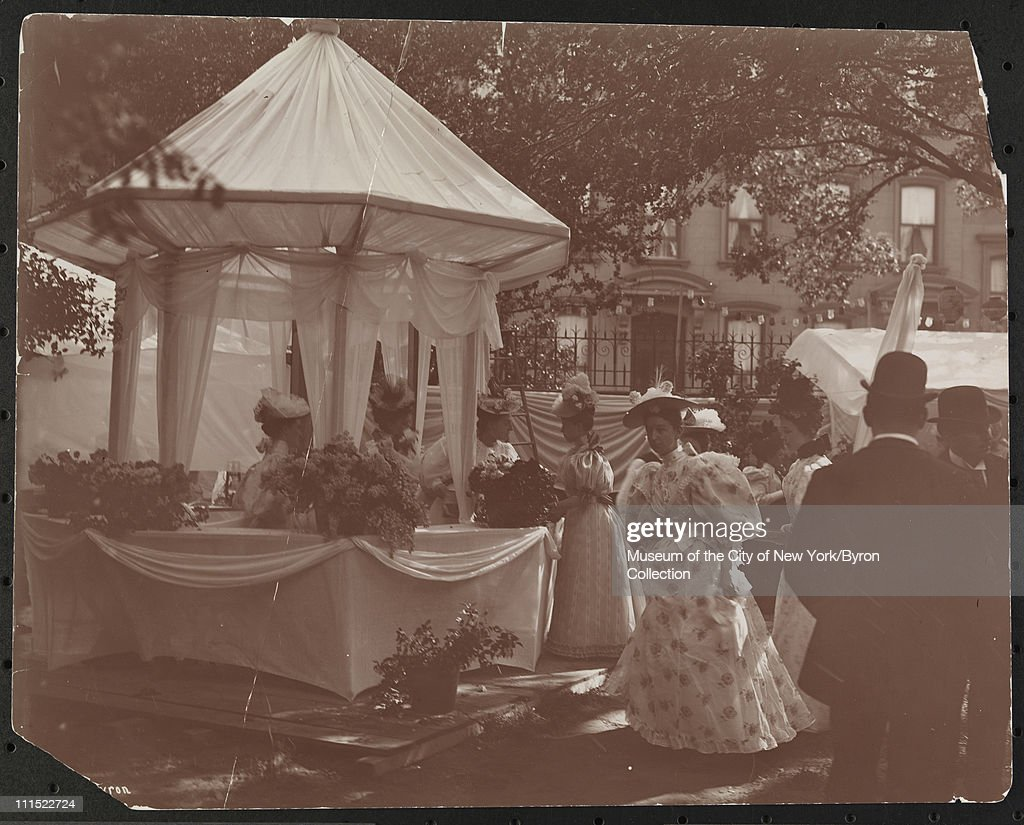 Men and women at a garden party at 37th Street and 5th Avenue to benefit Barnard College New York New York 1896