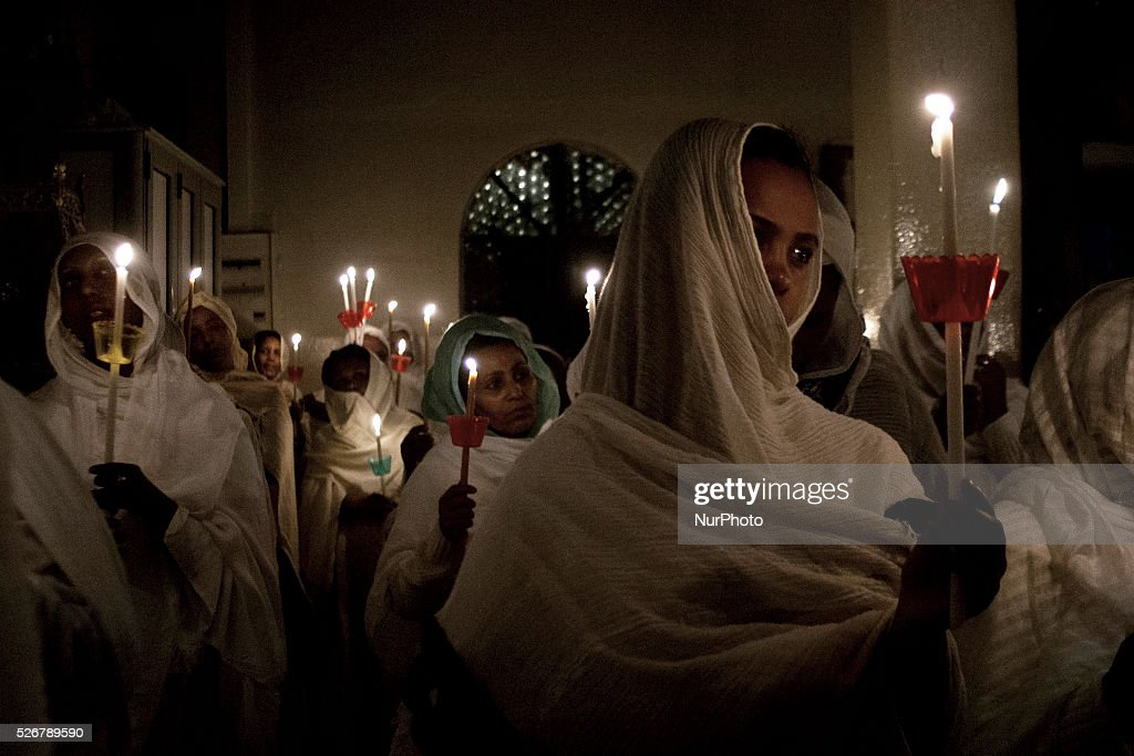 Men and women - barefoot and dressed in bleached almost silently pray early in the afternoon while the psalms accompany some drums, in the Ethiopian church, on May 1, 2016. Once the Paschal bells hit, shouts of joy resound throughout the sanctuary, on May 1, 2016.