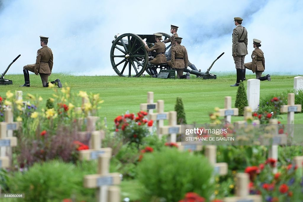Men and women dressed as World War I (WWI) soldiers load a cannon as they take part in the memorial ceremony on July 1, 2016 at the Thiepval Memorial, in Thiepval, during which Britain and France will mark the 100 years since soldiers emerged from their trenches to begin one of the bloodiest battles of WWI at the River Somme. Under grey skies, unlike the clear sunny day that saw the biggest slaughter in British military history a century ago, the commemoration kicked off at the deep Lochnagar crater, created by the blast of mines placed under German positions two minutes before the attack began at 7:30 am on July 1, 1916. / AFP / POOL / STEPHANE