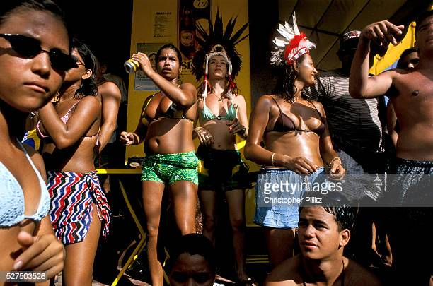 Men and women drinking and dancing during the celebrations of the 'Boi Bumba' Amazon Carnival Parintins Brazil The carnival serves to celebrate and...