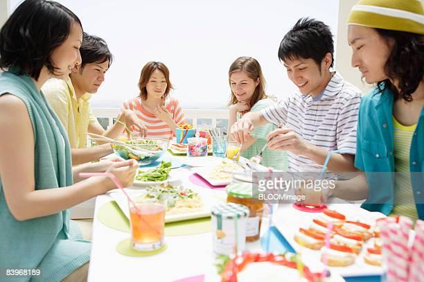 Men and women having birthday party