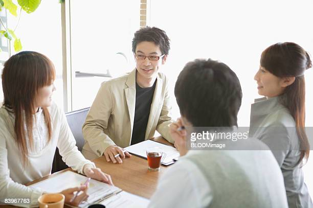 Men and women having meeting