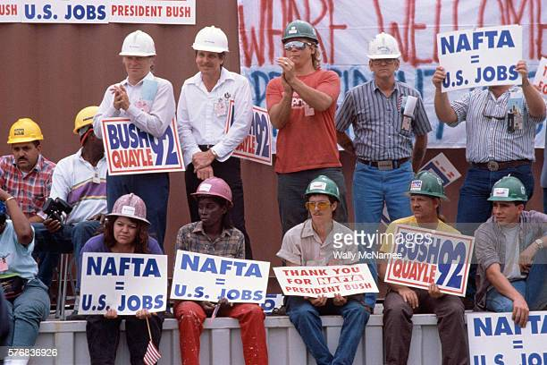Men and women hold signs supporting NAFTA and George Bush at a rally