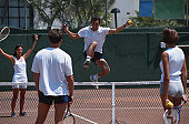 Men and women playing tennis, mixed doubles