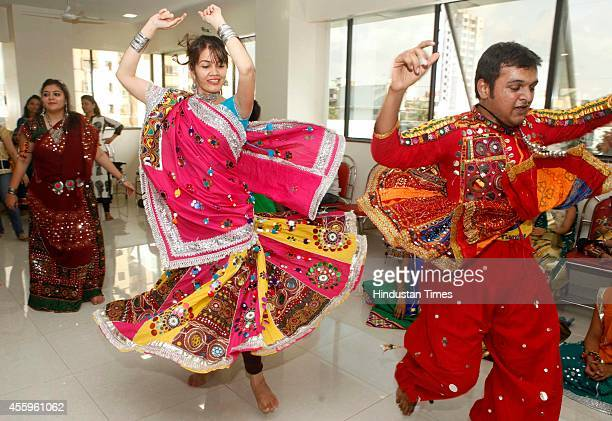 Men and women practicing for the Garba and Dandiya Raas dances performed during the Navratri festival celebration at Malad on September 22 2014 in...