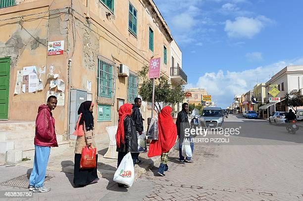 Men and women refugees make a walk in the center of Lampedusa on February 19 2015 Authorities on the Italian island of Lampedusa struggled to cope...