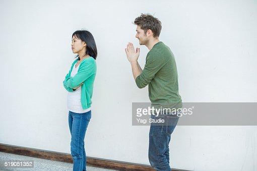 Men apologizing to women : Stock Photo