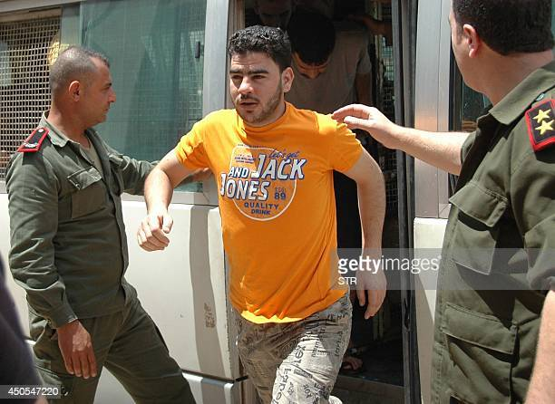 Men are freed from the central jail in the Syrian city of Homs on June 13 2014 after Syria begun releasing prisoners many of whom were held without...