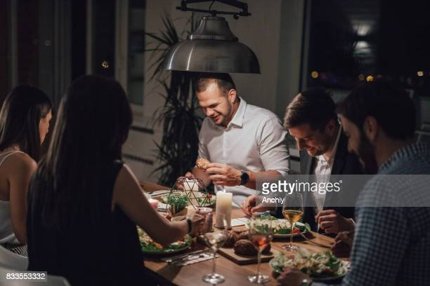 Men are laughing during dinner