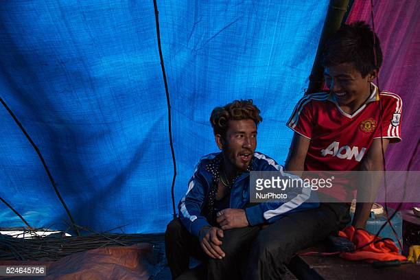 Men are pictured inside their temporary tent on the Araniko Road near the Kobani Village Isolated Nepalese Villagers still waiting for help and worry...