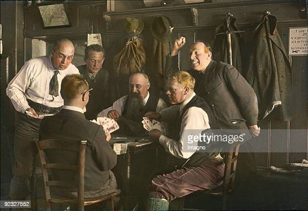 Men are playing cards in the KarlLudwighaus Rax Styria Handcolored lantern slide Around 1920