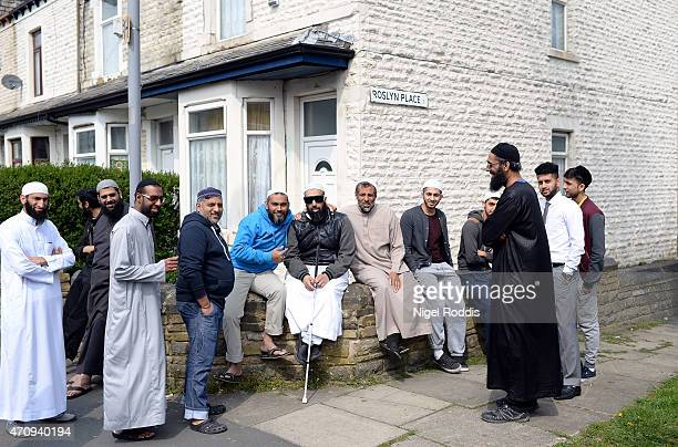 Men are seen after leaving the Masjid Noorul Islam mosque during a visit by the Respect Party's George Galloway on April 24 2015 in Bradford England...