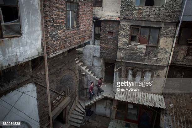 Men are seen inside the Valide Han on May 10 2017 in Istanbul Turkey The hans of Istanbul are courtyard areas off the main roads and primarily...