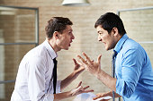 Two businessmen fighting at office