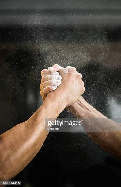 Men arm wrestling at the gym