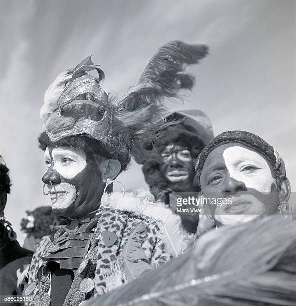 Men at a Mardi Gras event in blackface are dressed as African tribesman New Orleans Louisiana