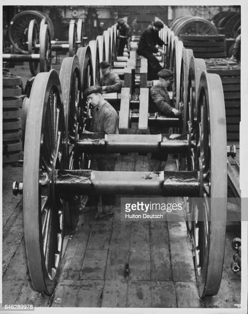 Men at a North Road workshop assemble wheels for 100 locomotives under construction for the London and North Eastern Railway company