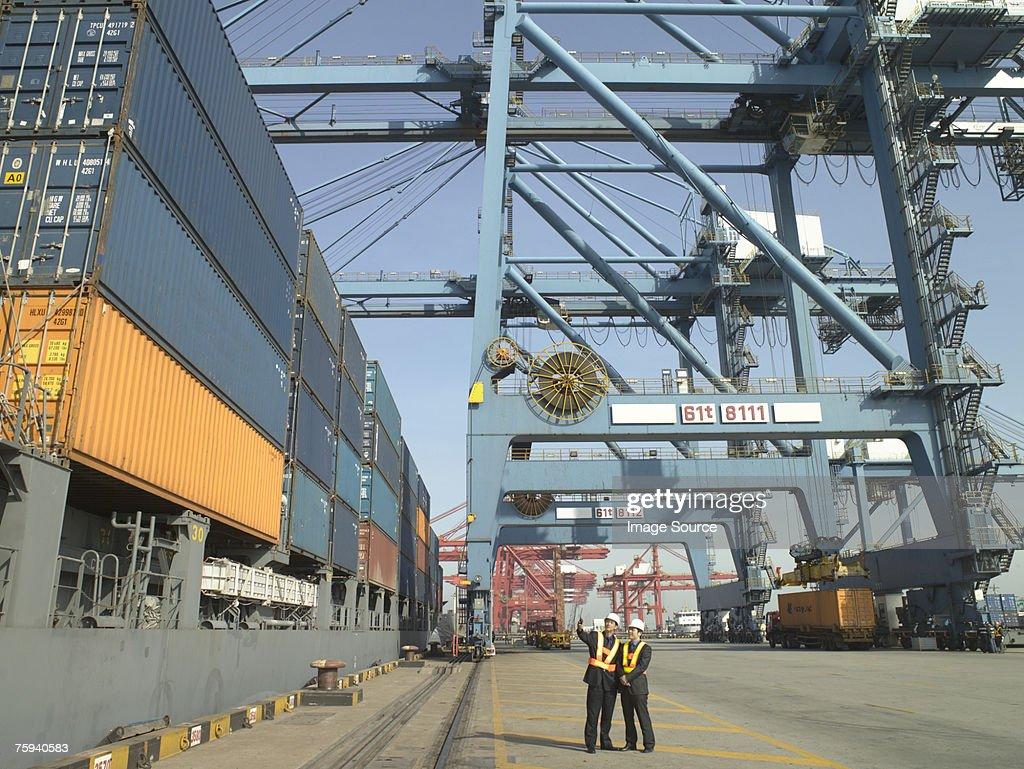 Men at container terminal