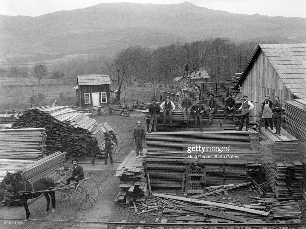 Men at lumberyard late 1880s