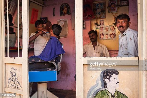 Men at the barbershop in Badami Karnataka India
