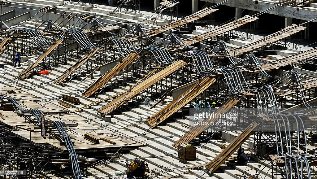 Men at work at Maracana stadium seen during a tour for journalists organized by the Rio 2016 Committee on November 19, 2012 in Rio De Janeiro, Brazil. AFP PHOTO / ANTONIO SCORZA