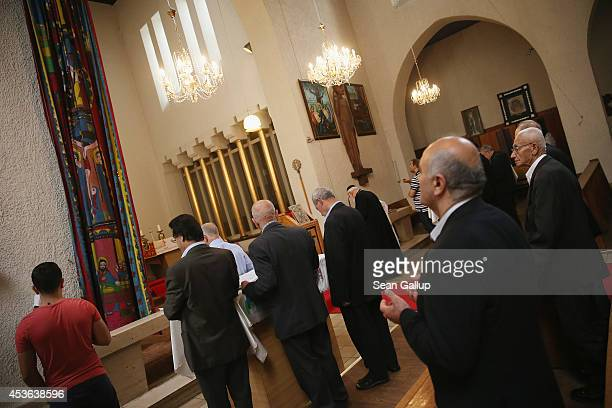 Men attend a threehour Mass at the St Jacob Syrian Orthodox Antioch Church on Assumption Day on August 15 2014 in Berlin Germany In Christian...