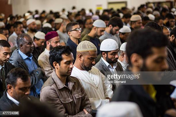 Men attend the first Friday prayers of the Islamic holy month of Ramadan at the East London Mosque on June 19 2015 in London England Muslim men and...