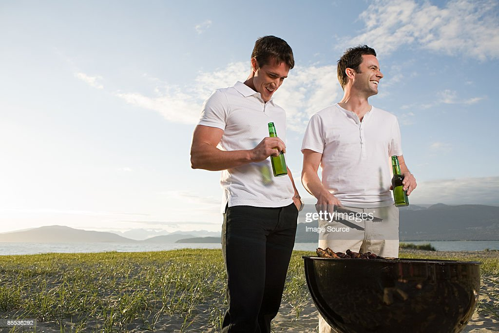 Men barbecuing on an island : Stock Photo