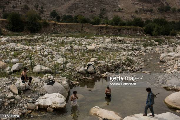 Men bathe in a river in the Momand Valley on July 16 2017 in Achin District Afghanistan The area is where the United Staes dropped the GBU43/B...
