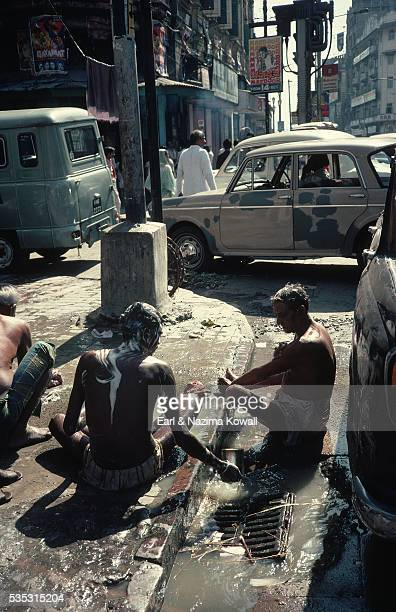 Men Bathing in Gutter of Calcutta Street
