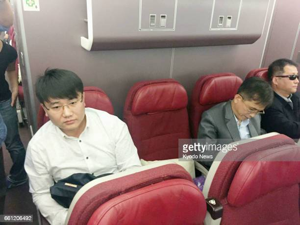 Men believed to be North Koreans are on a plane ahead of its departure from Kuala Lumpur for Beijing on March 30 2017 Two North Korean men linked to...