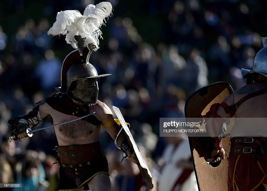 Men belonging to historical groups fight dressed as ancient Roman gladiators during a show to mark the anniversary of the legendary foundation of the eternal city in 753 B.C, in Rome's Circo Massimo on April 21, 2013. AFP PHOTO / Filippo MONTEFORTE
