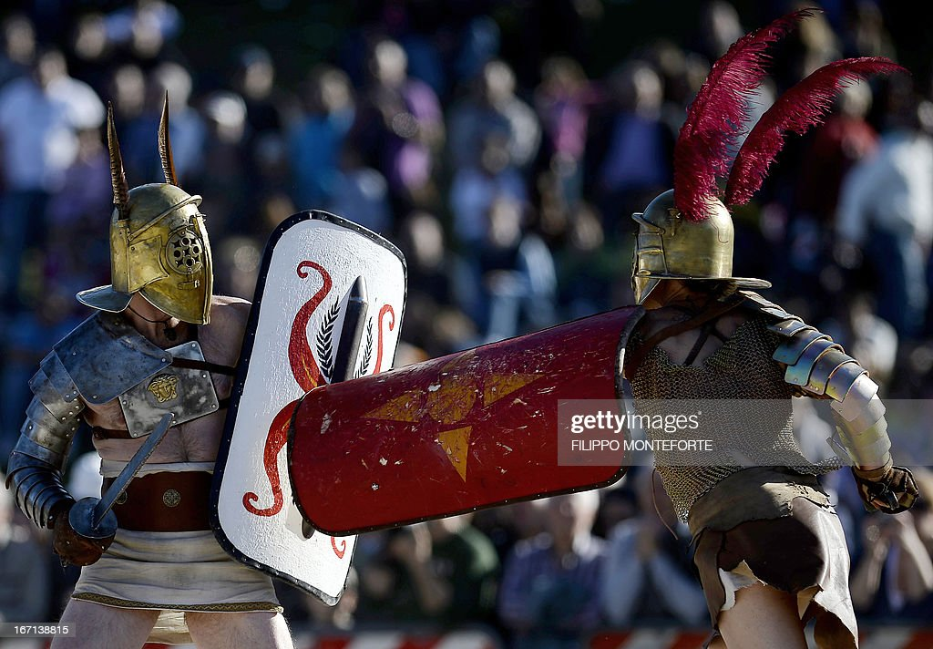 Men belonging to historical groups fight dressed as ancient Roman gladiators during a show in Rome's Circo Massimo on April 21, 2013 to mark the anniversary of the legendary foundation of the eternal city in 753 B.C. AFP PHOTO / Filippo MONTEFORTE