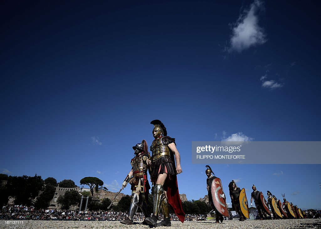 Men belonging to historical groups parade dressed as ancient Roman soldiers during a show to mark the anniversary of the legendary foundation of the eternal city in 753 B.C, in Rome's Circo Massimo on April 21, 2013. AFP PHOTO / Filippo MONTEFORTE