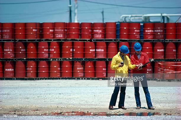 Men by oil barrels