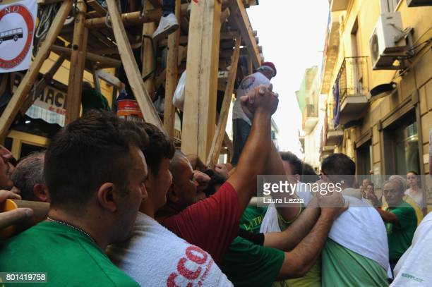 Men carry a 25metre tall wood and papiermache statue called 'giglio' during the annual Festa dei Gigli on June 26 2017 in Nola Italy When St Paolini...